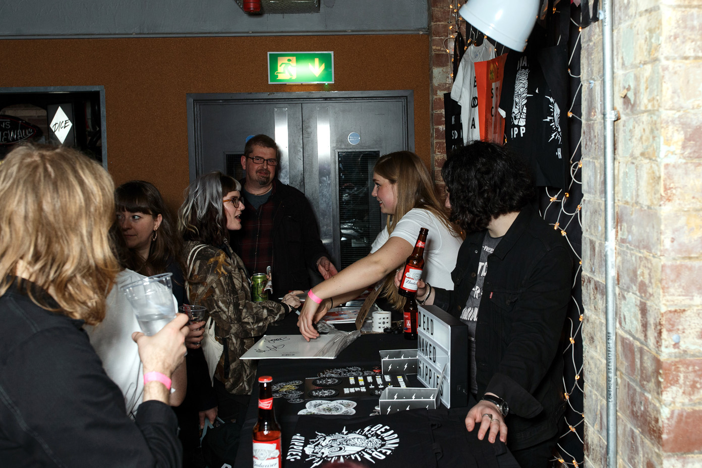 Nelson Can meeting fans at the merch stand after the show
