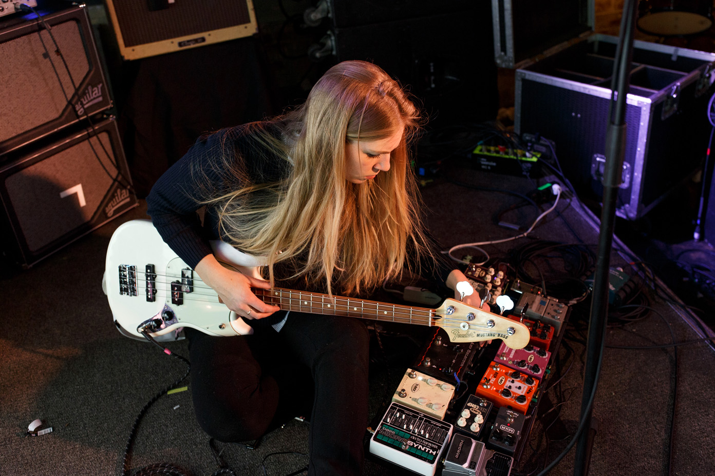Signe setting up her pedals during soundcheck